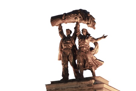 soviet statue collective farmers with huge sheaf of wheat