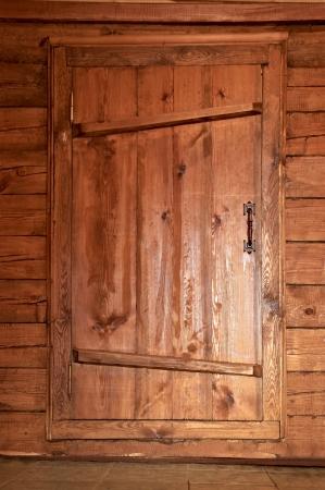 solid wooden door with a metal handle photo