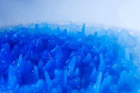 Abstract background formed by mixing blue paint photo