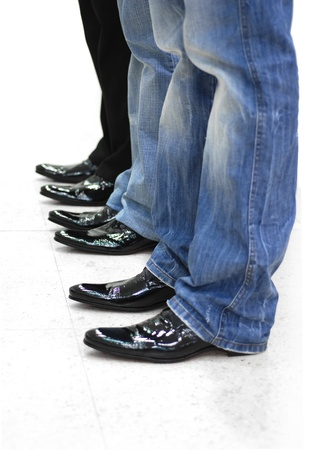 feet of three men in black leather shoes Stock Photo - 10179083