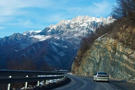Winding mountain road in winter in Montenegro photo