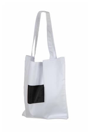 petit sac en coton blanc isolé sur blanc