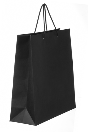 dark paper shopping bag isolated on white photo