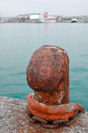 cleat: A rusty bollard. Abstract travel background.