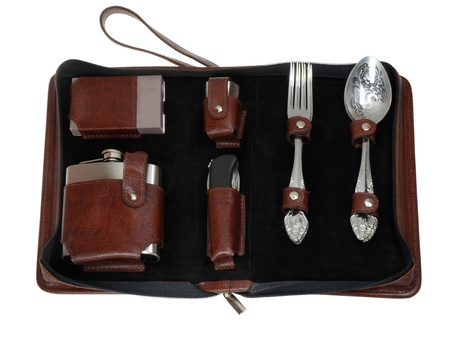 compact travel kit in brown leather case photo