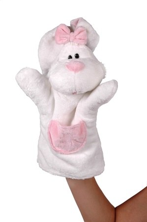 Hand puppet of white rabbit isolated on white photo