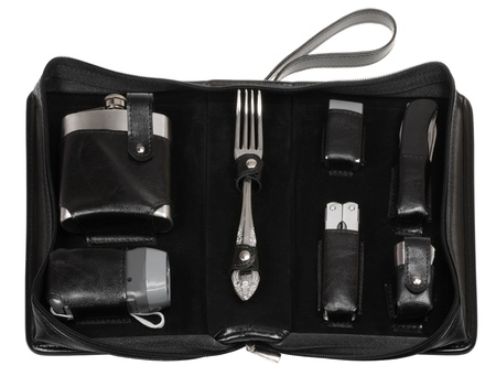 compact travel kit in black leather case photo