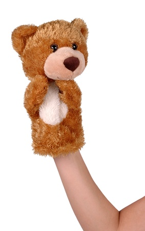 Hand puppet of brown bear isolated on white photo