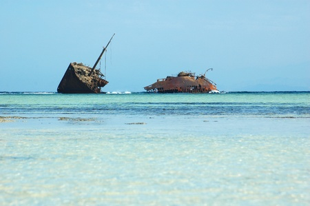 shipwreck: rusty ship run aground on the shore in Egypt
