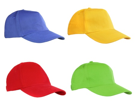 Four caps isolated on white. Blue, yellow, red and green.