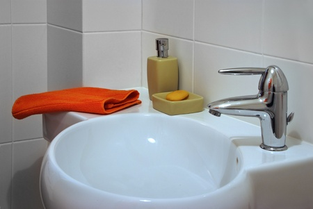 surface of white sink in interior bath room photo