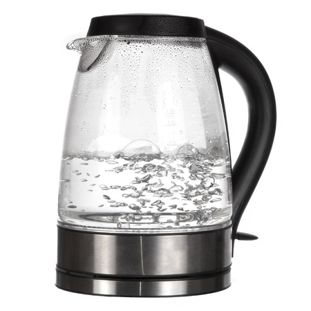 Tea kettle with boiling water isolated on white photo