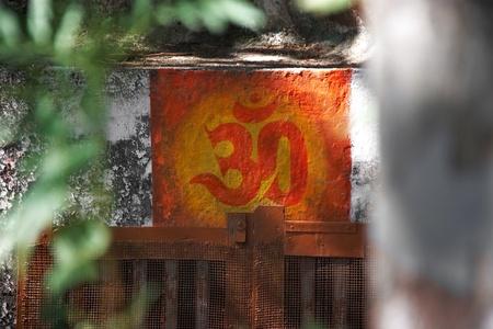 sadhu: ohm symbol painted on the wall