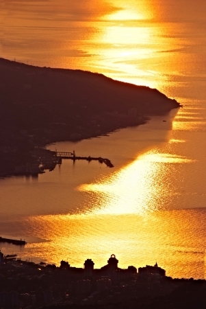 sunrise over coastal town, Yalta, Ukraine Stock Photo - 13677882