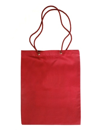 red cotton bag isolated on white photo