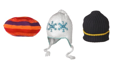 pompon: set of winter hats isolated on white