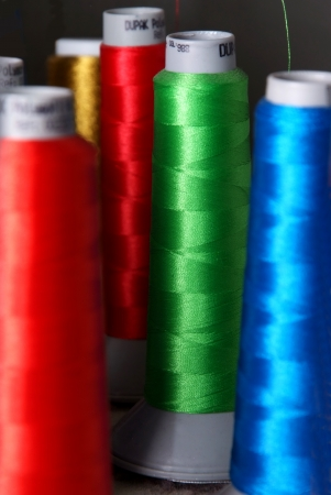 colorful spools of threads photo