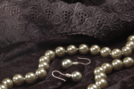 pearl necklace and earrings on black velvet photo