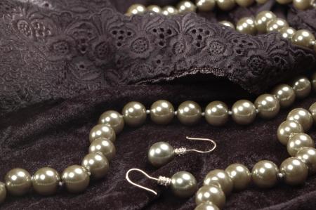 pearl necklace and earrings on dark velvet photo