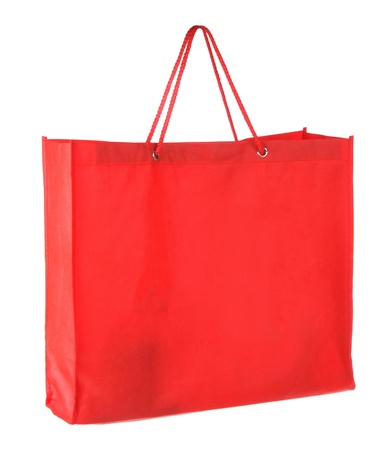 red tissue shopping bag isolated on white  photo