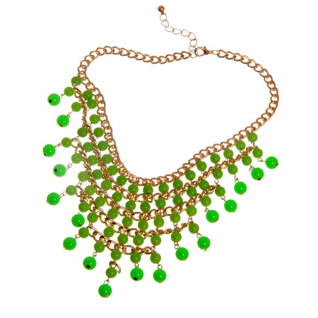 golden necklace with green beads isolated on white background  photo