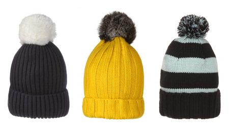 set van de winter hoeden met pompon op wit wordt geïsoleerd Stockfoto