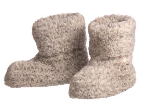 valenki: valenki - russian felt boots on white background  Stock Photo