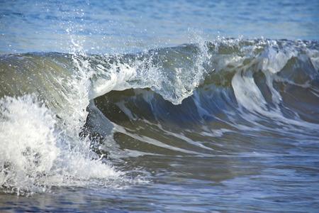 shorebreak: Blue breaking curled shorebreak wave  Stock Photo
