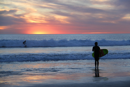 surfgirl if front of beautiful sunset Stock Photo