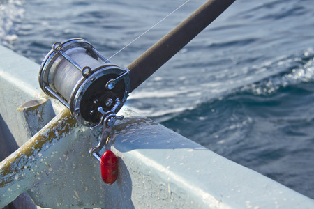 heavy fishing reel on the shipboard photo