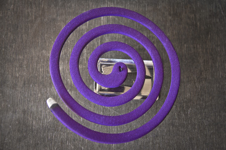 top view of a burning mosquito coil photo