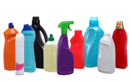 Many different plastic bottles of cleaning products isolated on white
