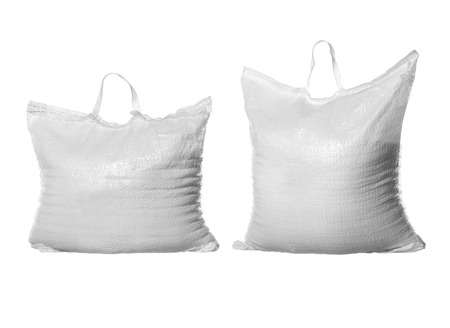 Two bags of white refined sugar isolated on white photo