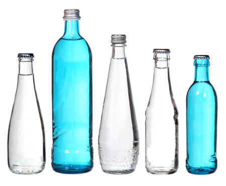 collection of glass bottles isolated on white  photo