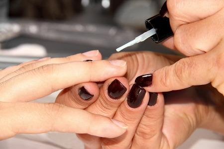 Close up of process of manicure at beauty salon  photo