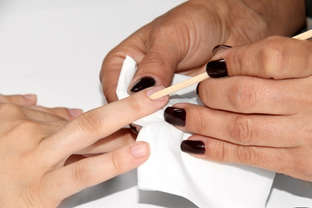 close up of a manicure process in beauty salon photo
