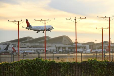 Airplane landing on runway in LA Airport