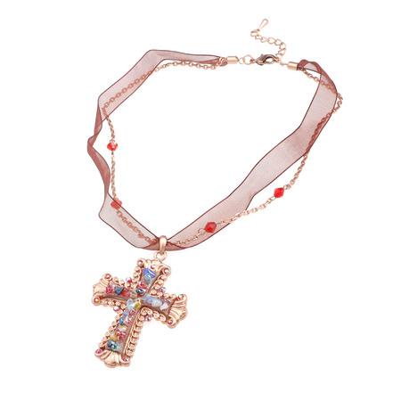 glamourous cross pendant isolated on white photo