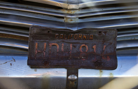 car grill: old rusty car plate on radiator grill Stock Photo