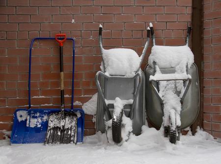 winder: snow showels and wheelbarrows in winder yard