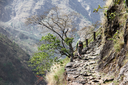stair climber: hiker climbs up on the hill enjoying the view