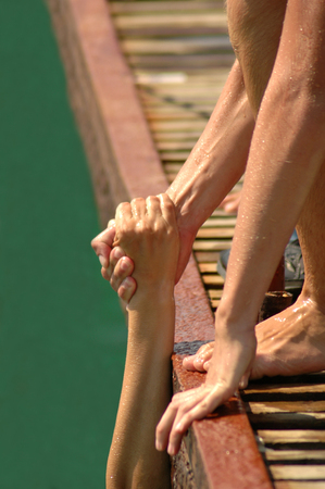get up: helping hands to get up between two persons