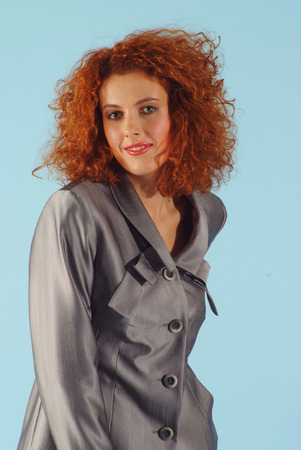 red haired girl: red haired girl in grey jacket