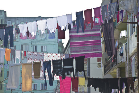 Washed laundry hanging in front of the windows of the facade in Batumi, Georgia Banque d'images