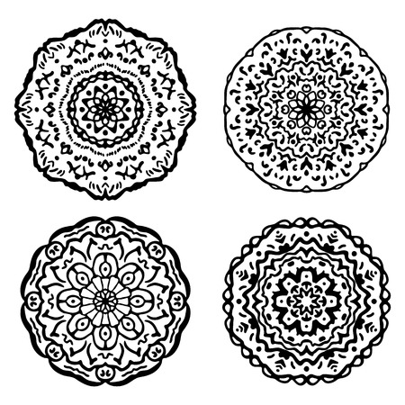 meditative: Set of black and white mandalas. illustration isolated on white. Ethnic design elements. floral motifs