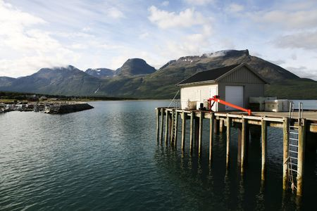 Norwegian mountains seen from a small harbor. photo