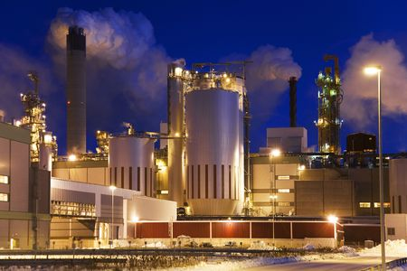 heavy industry: Paper mill by night. Blue winter sky immediately after sunset, Stock Photo