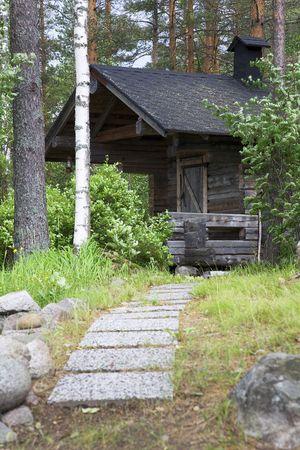 finland�s: Una sauna finlandesa de humo por el lago Saimaa.