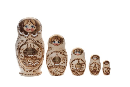 matryoshkas: Matryoshkas  Russian nesting dolls in a row  A traditional Russian wood handicraft  Very popular souvenir and collectible