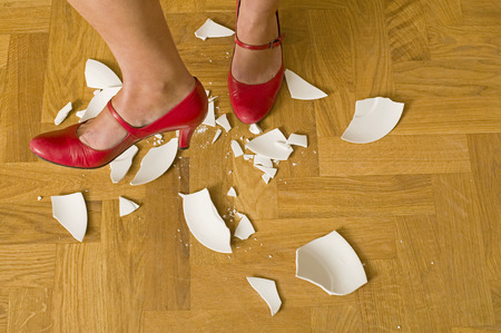 womans foot stamping on plate in a rage photo